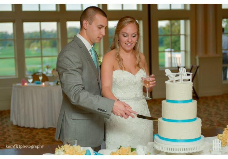 cutting the cake Baywood Greens wedding